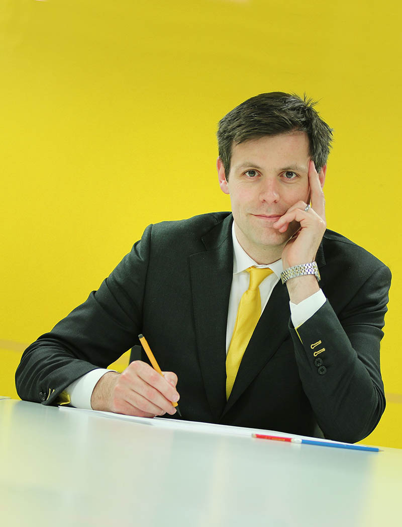 Image of Will Baxter with yellow background